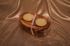 Handmade double tealight candle holder in yew by Wood Cave