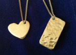 Hammered solid silver heart and rectangle pendants hand made by Wood Cave