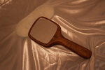 Handmade sapele hand mirror by Wood Cave